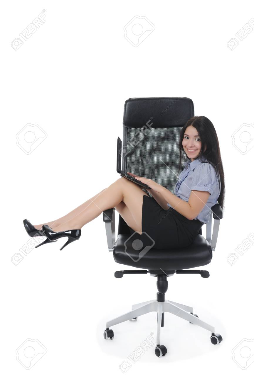 Businesswoman with laptop sitting on a chair in a bright room. Isolated on white background Stock Photo - 8061884