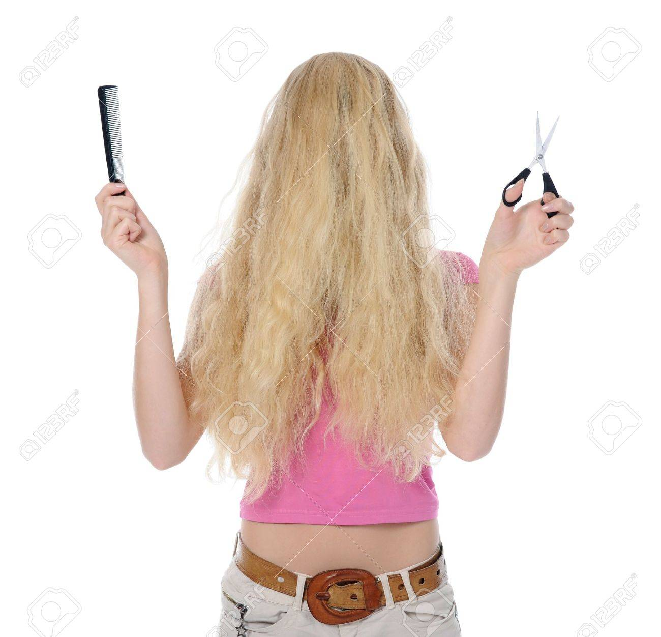 young woman with backcombing hair and scissors. Isolated on white background Stock Photo - 8061880