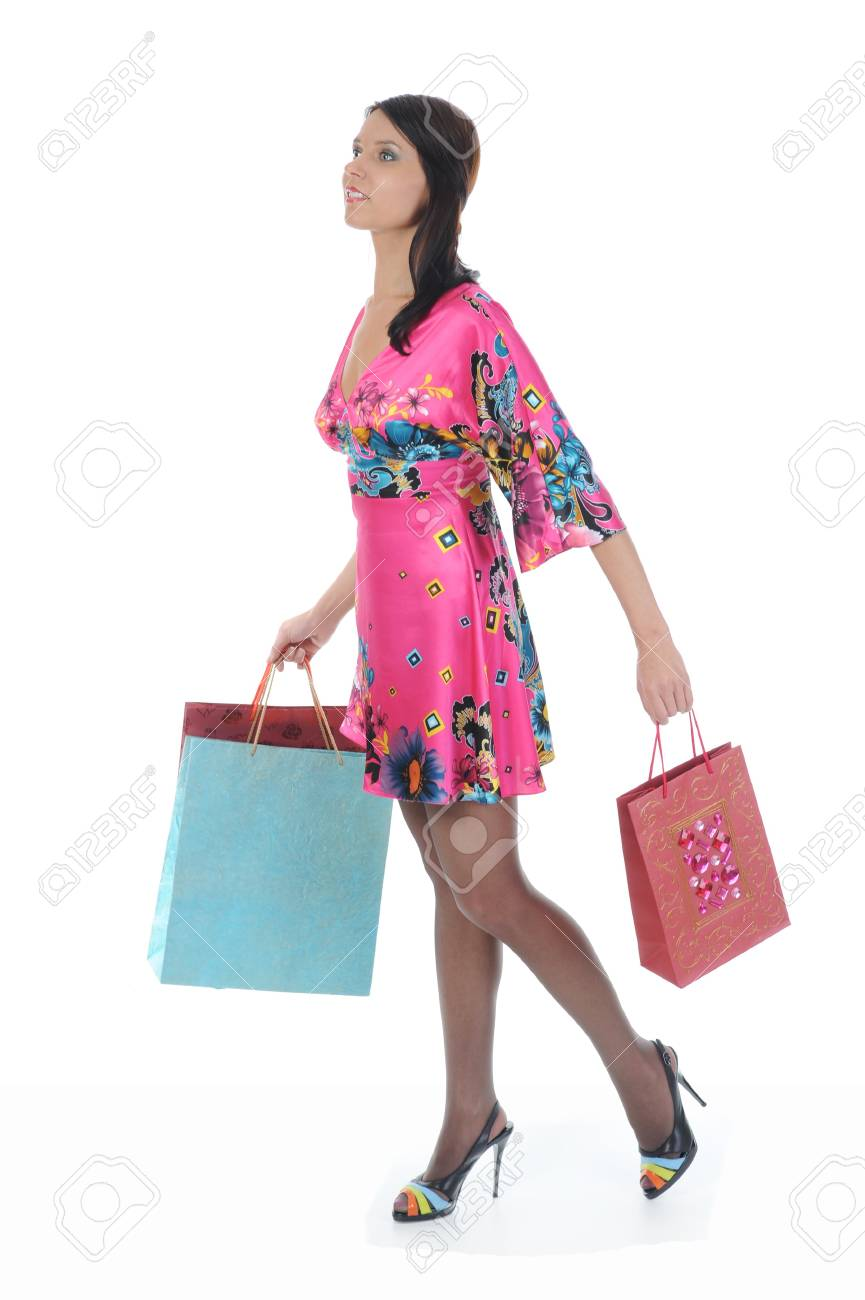 beautiful woman in a full-length with shopping bags. Isolated on white background Stock Photo - 8061946