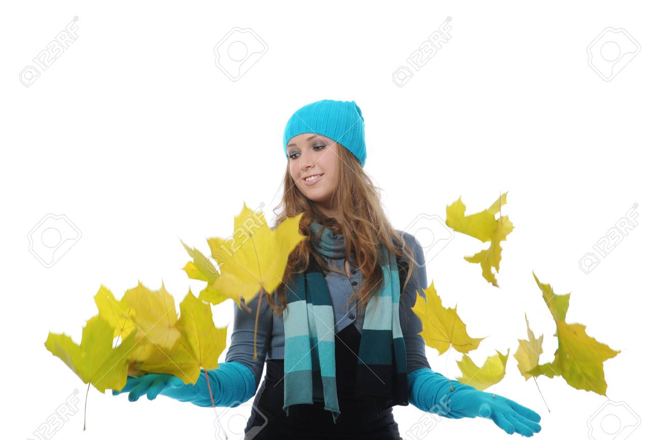 Smiling woman in winter style with a maple leaf in his hand. . Isolated on white background Stock Photo - 8061944