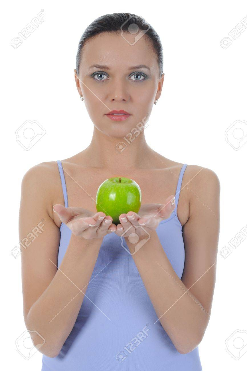 Athletic girl holding a green apple in hand. Isolated on white background Stock Photo - 8133723