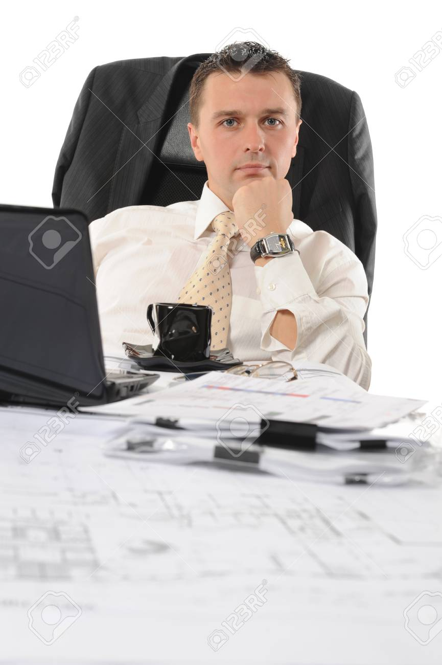 Businessman sitting before a computer. Isolated on white background Stock Photo - 8172717
