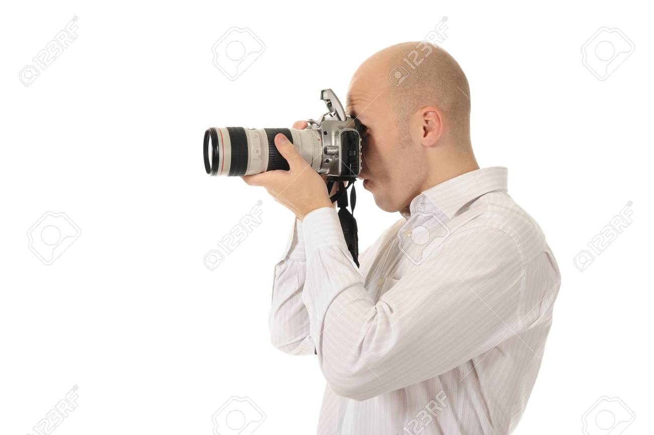 man holds a camera in his hands. Isolated on white background Stock Photo - 8172700
