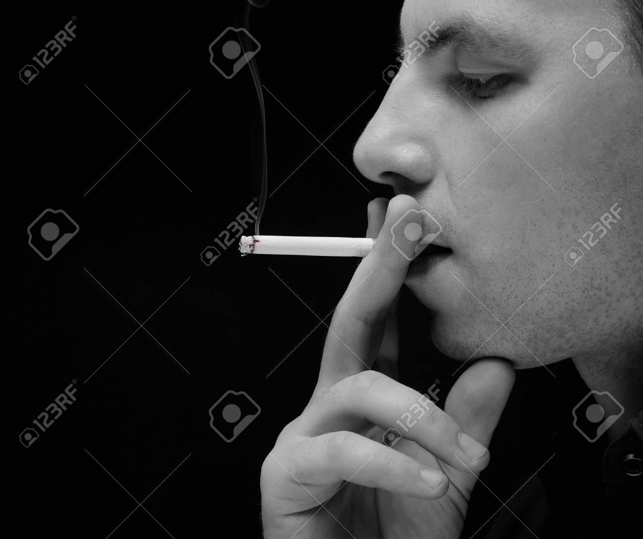 young man smokes a cigarette Stock Photo - 8182033