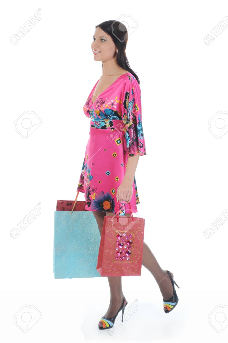 beautiful woman in a full-length with shopping bags. Isolated on white background Stock Photo - 8355511