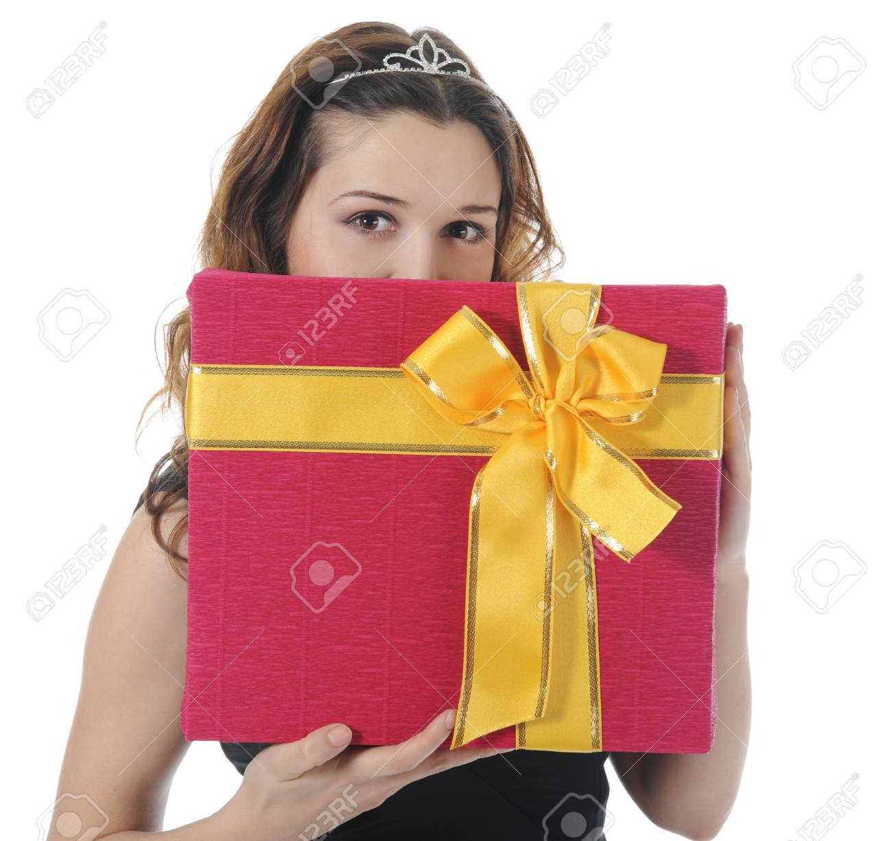 Long-haired brunette in pink dress with a gift box. Isolated on white background Stock Photo - 8355582