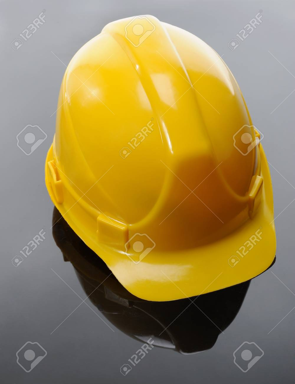 Image of yellow construction helmet on a black background Stock Photo - 8355580