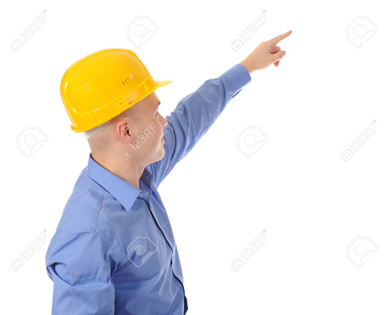 Businessman in helmet points finger up. Isolated on white background Stock Photo - 8355600