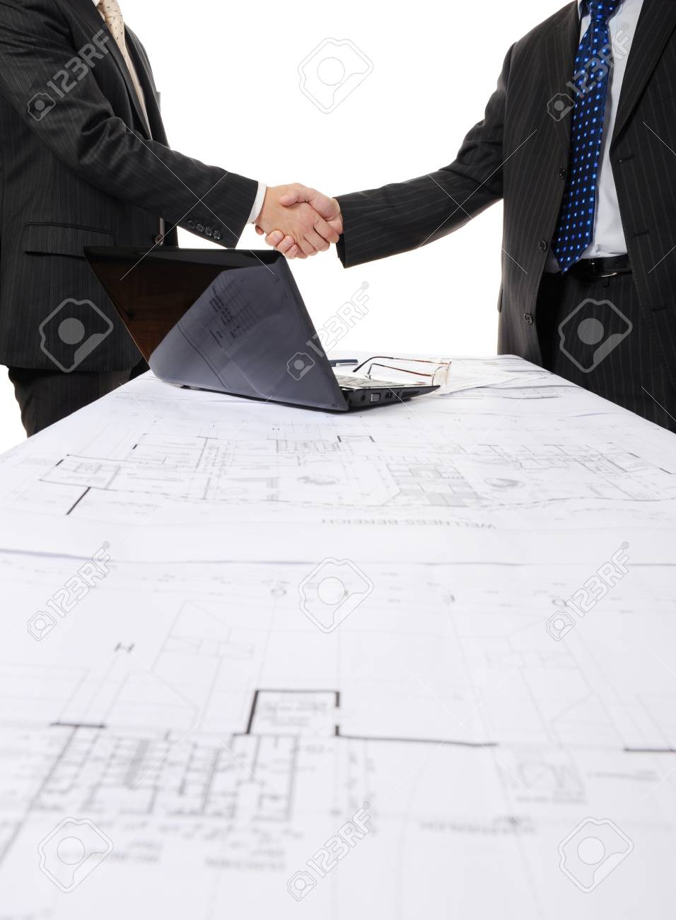Handshake of two business partners after signing a contract. Focus on the documents Stock Photo - 8404338