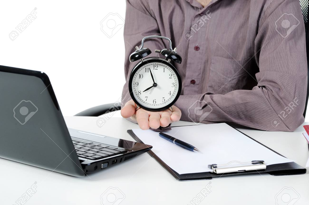 Businessman holding a alarm clock. Isolated on white background Stock Photo - 8442481
