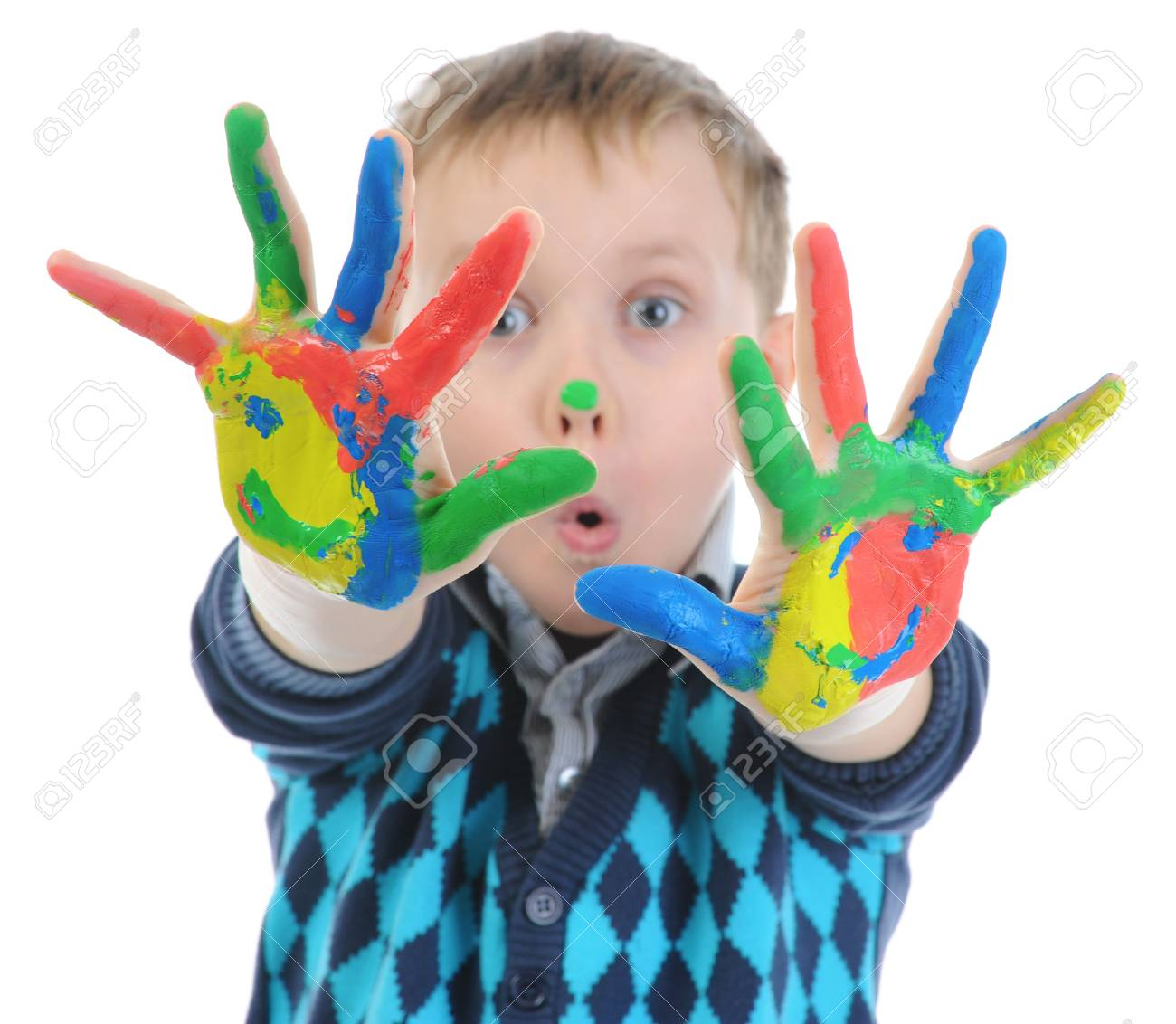 smiling boy with the palms painted by a paint. Stock Photo - 9319073