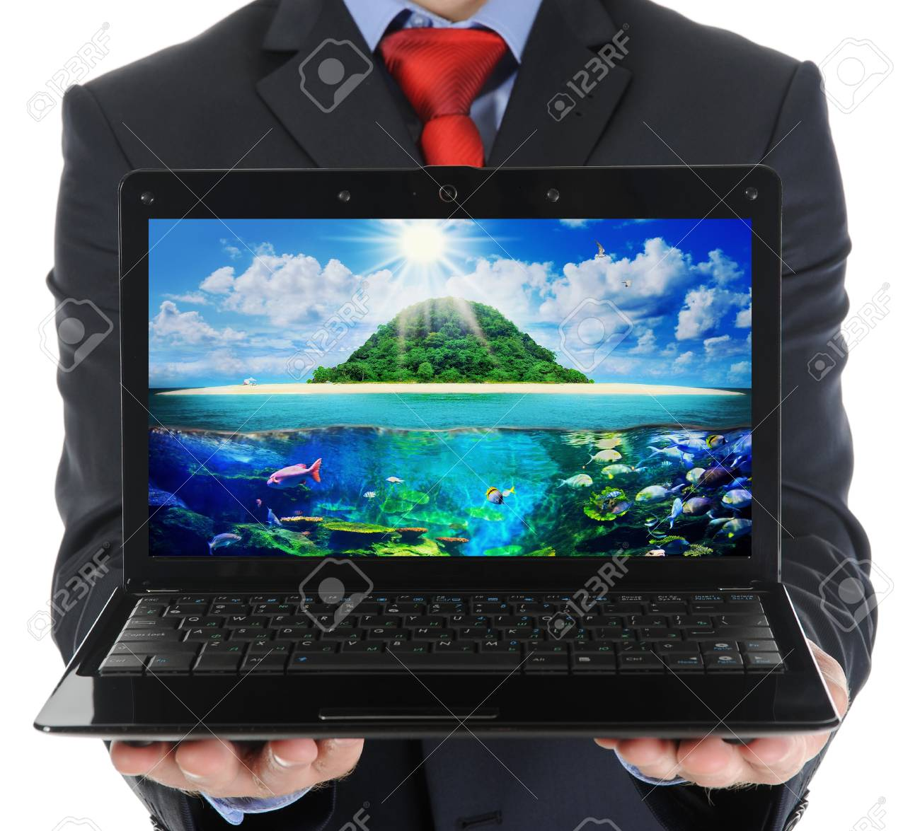 Businessman holding an open laptop Stock Photo - 17705847