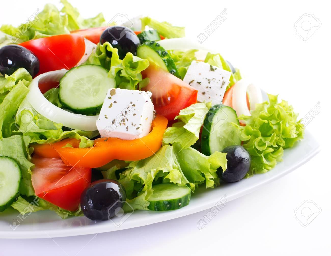 fresh vegetable salad isolated on white background - 125327251