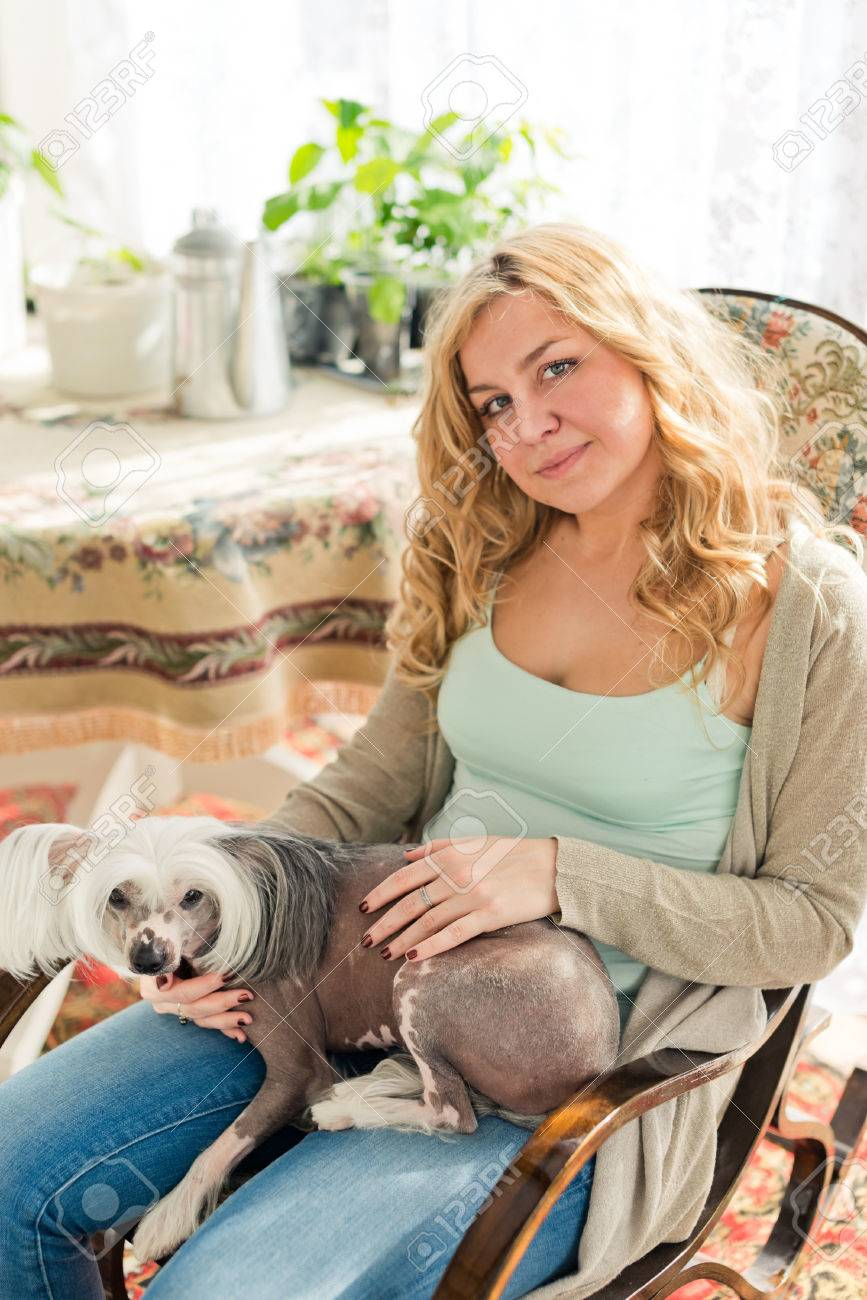 Swell Blond Woman And Chinese Crested Dog In Rocking Chair Squirreltailoven Fun Painted Chair Ideas Images Squirreltailovenorg