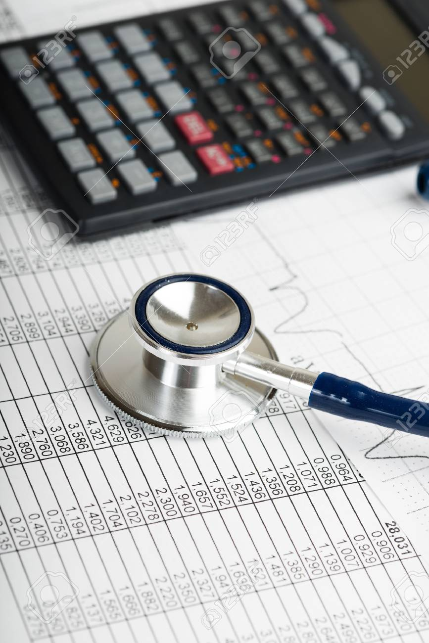 Health care costs. Stethoscope and calculator symbol for health care costs or medical insurance - 33214435