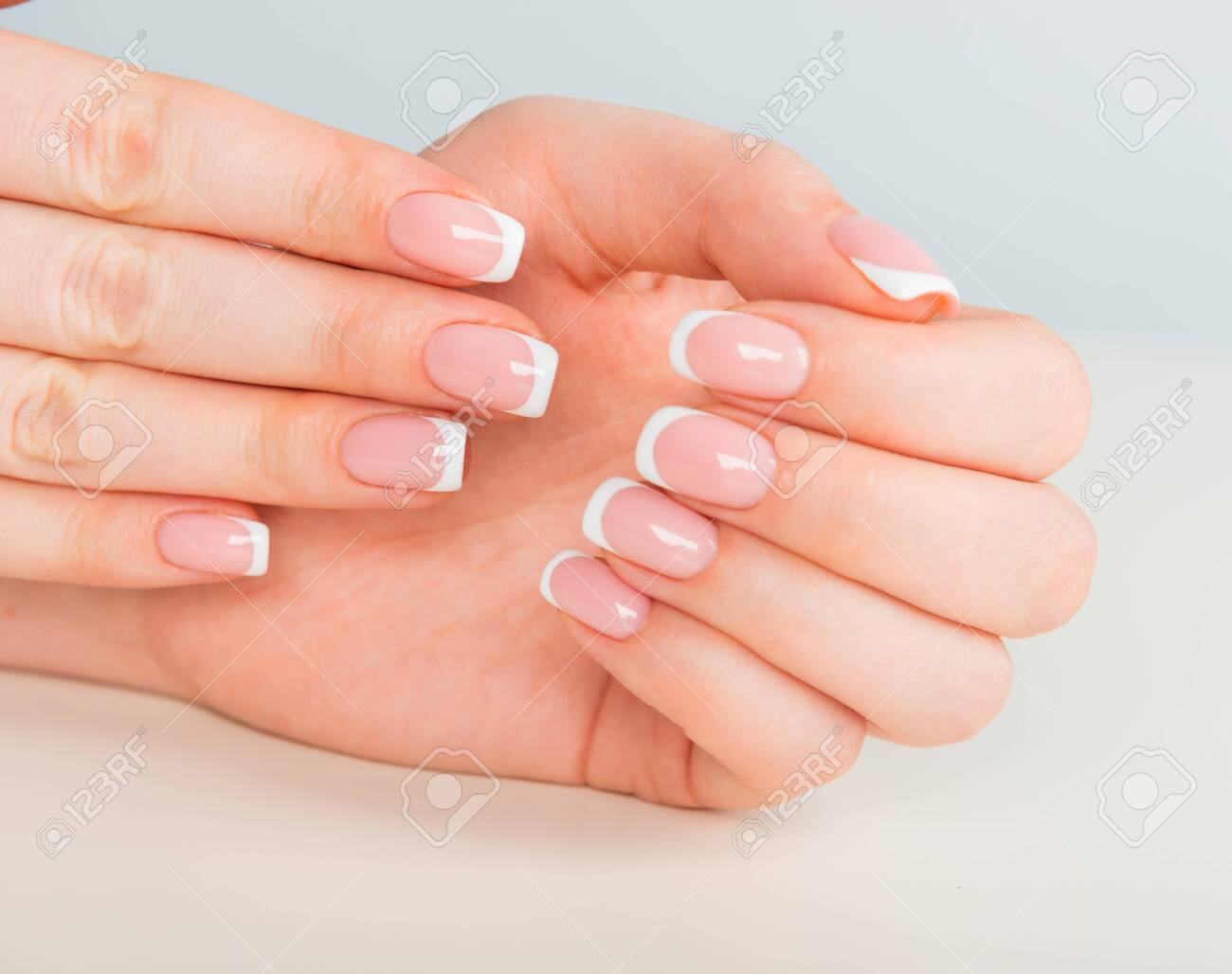 Beautiful woman's hands with beautiful nails after manicure salon with french manicure - 121699667
