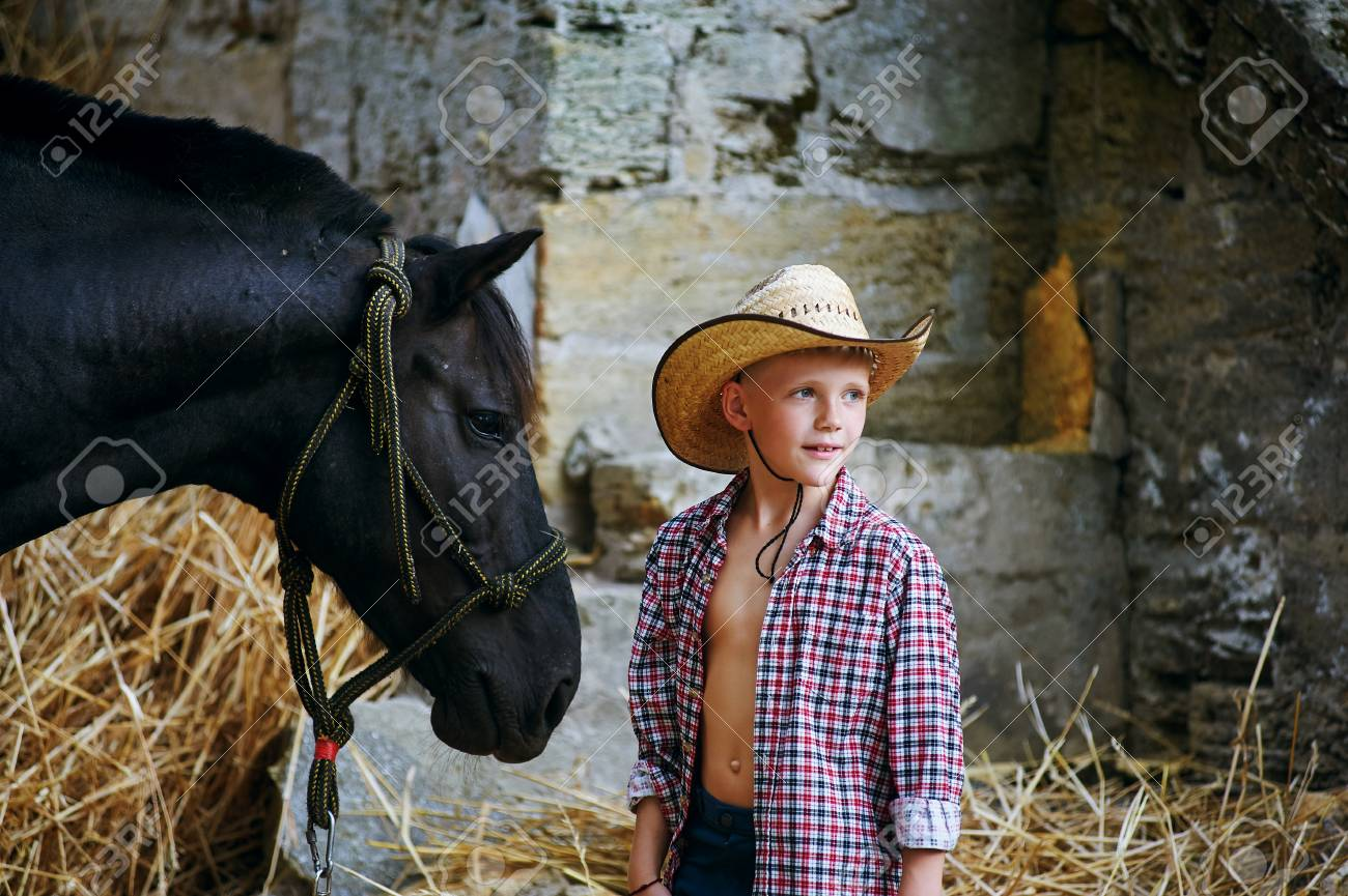 The Boy Next To His Horse Stock Photo Picture And Royalty Free Image Image 78065566