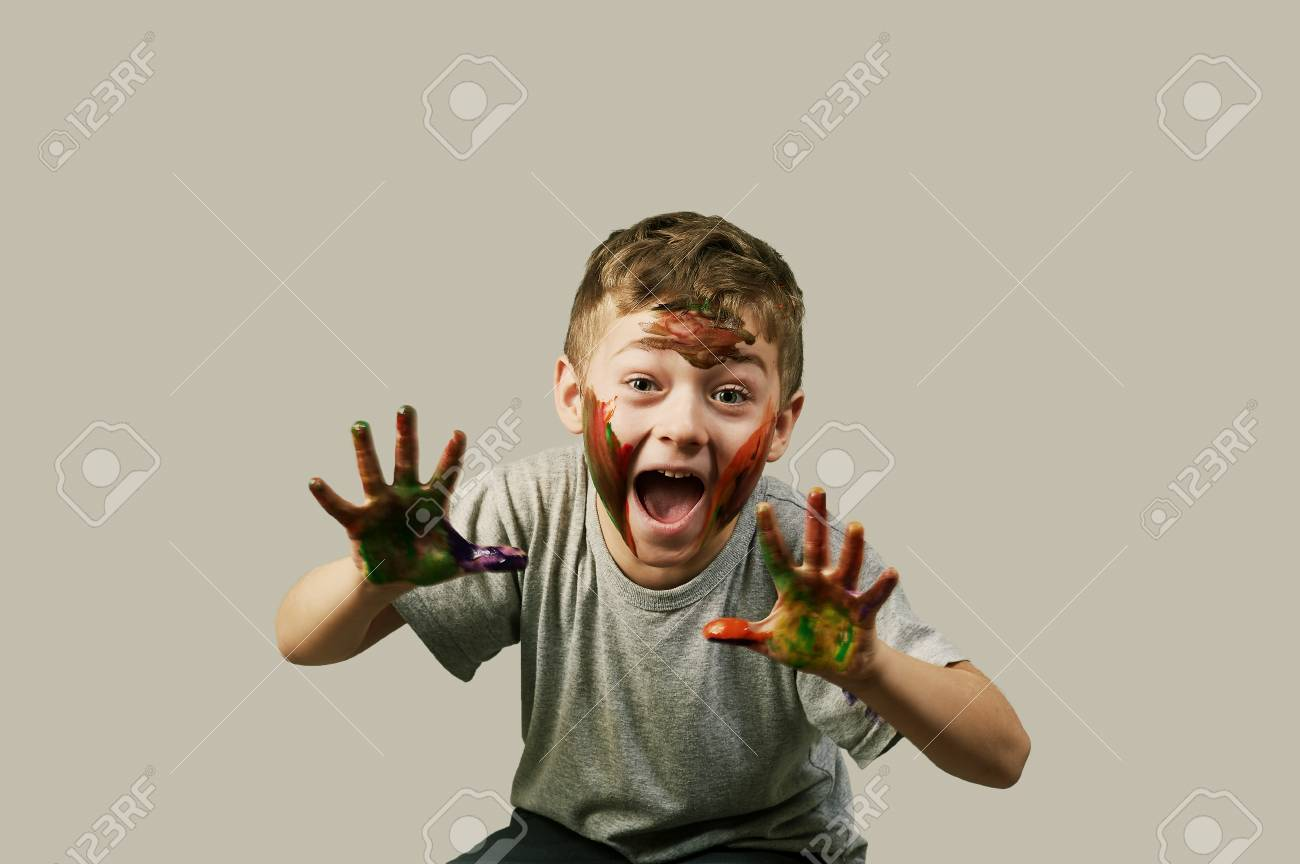 Beautiful gay boy in paint on the hands and face