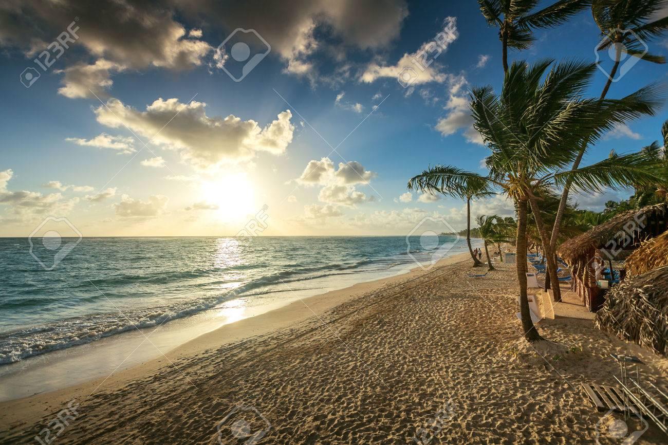 Carribean vacation, beautiful sunrise over tropical beach in Punta Cana - 51311818