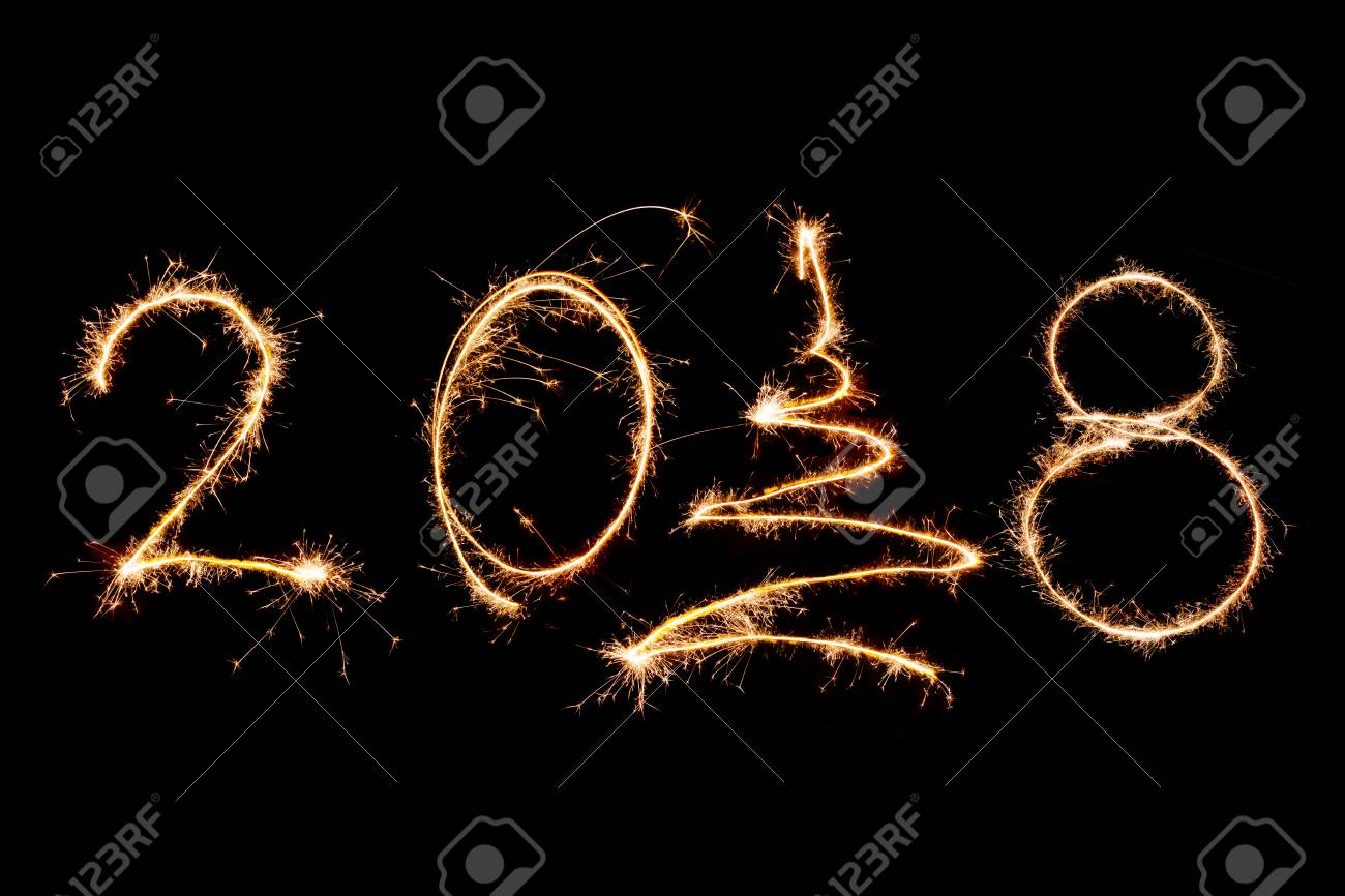 2018 written with sparkle firework on black background happy new year 2018 concept stock