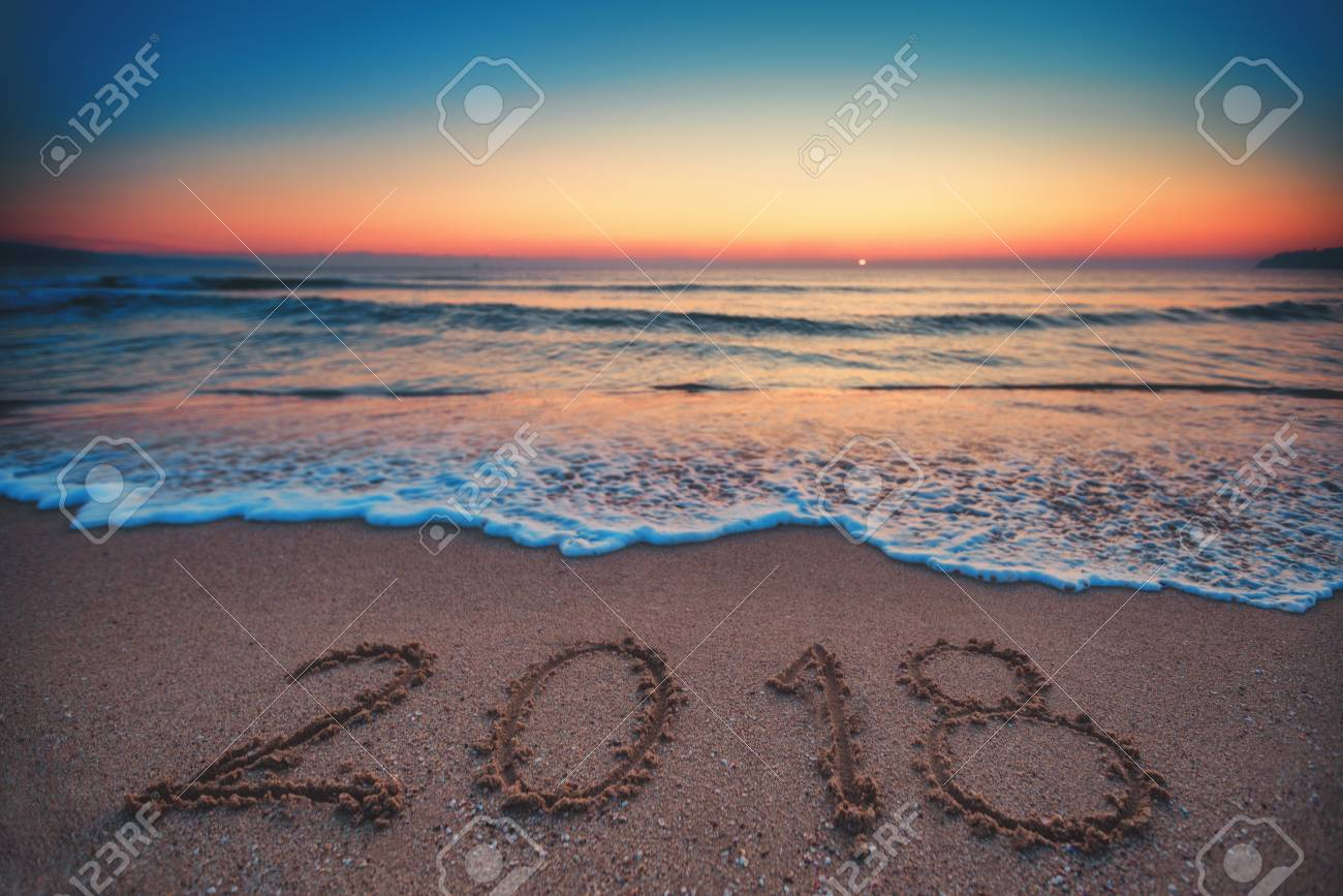 Happy New Year 2018 concept, lettering on the beach. Sea sunrise. - 91889302