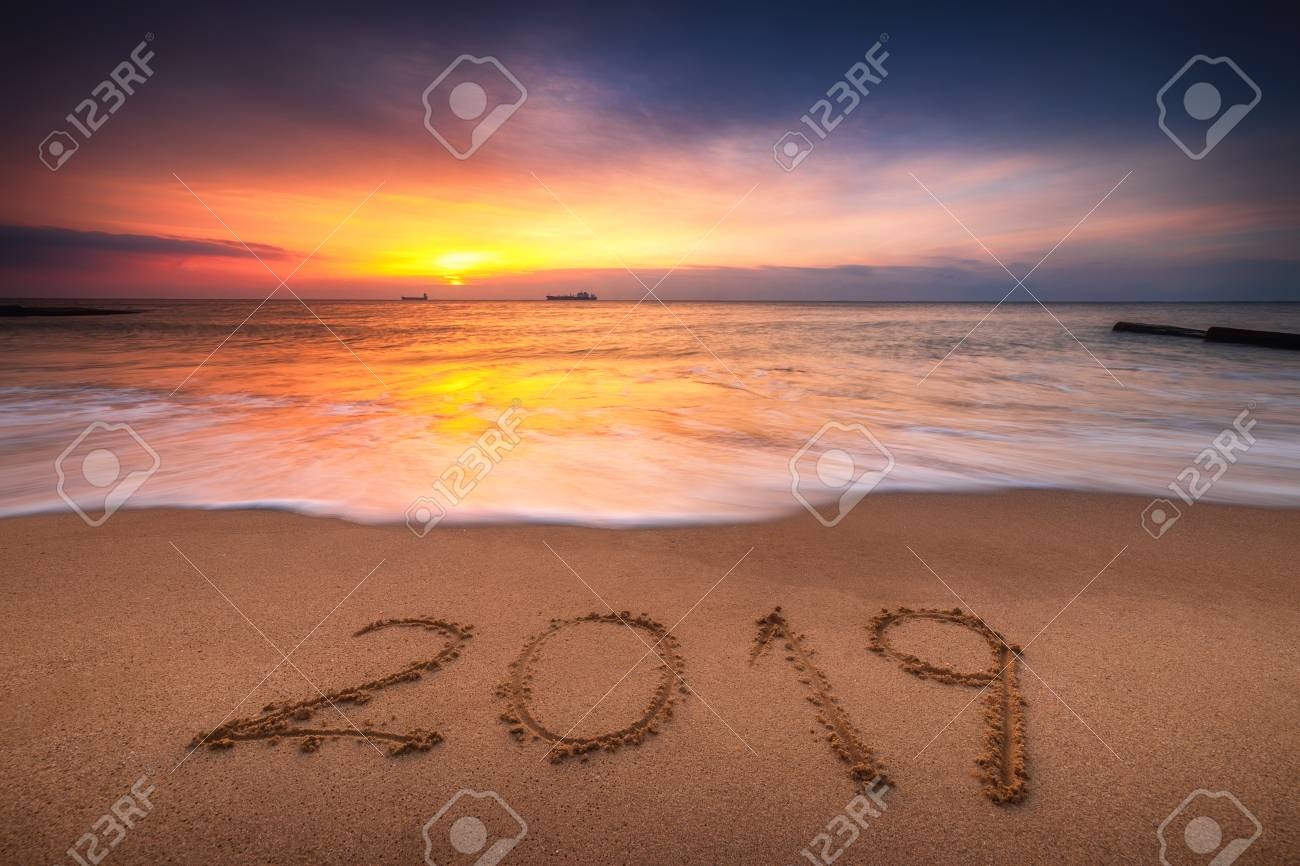 happy new year 2019 concept lettering on the beach sea sunrise