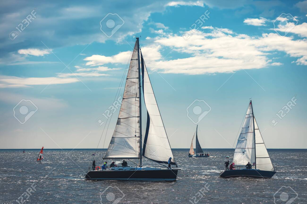 Sailing ship yacht with white sails in the sea. - 124562344