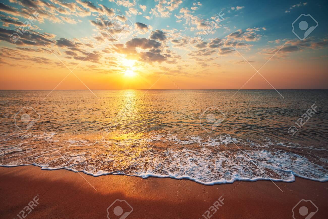 Beautiful sunrise over the tropical sea. - 129728354