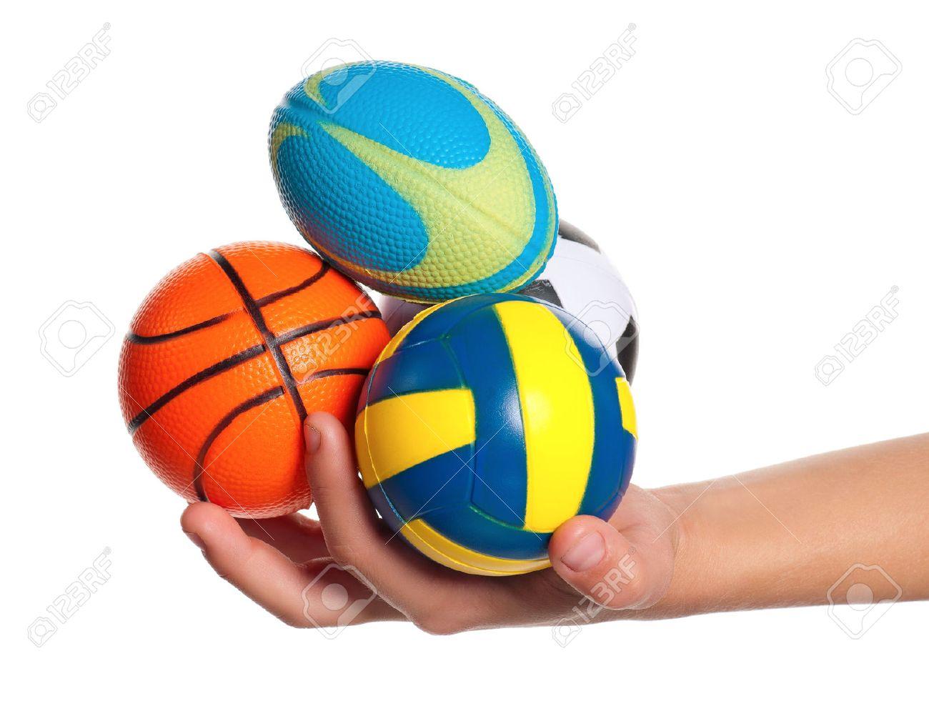 f3a4034726f28 Foto de archivo - Niño con la mano pequeña de voleibol