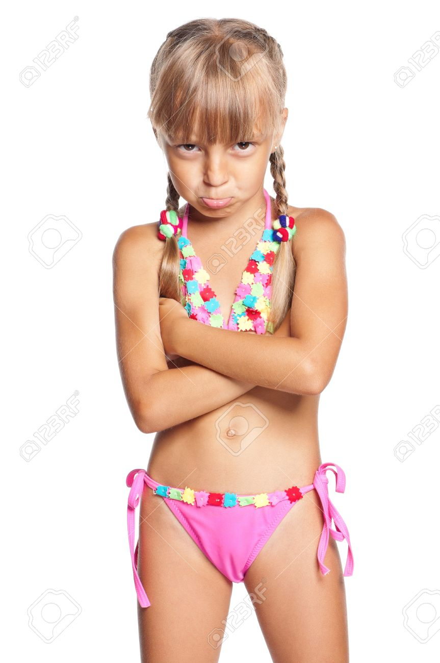 40a175e6aa Stock Photo - Unhappy little girl in swimsuit isolated on white background