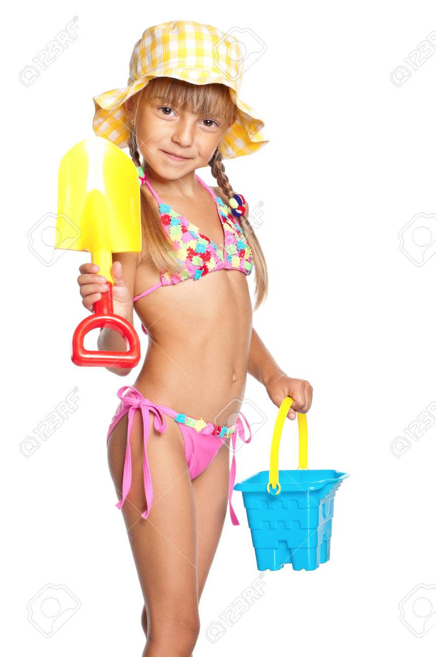 cea1ad90ae Adorable little girl standing in swimming wear and panama hat with bucket  and spade, isolated