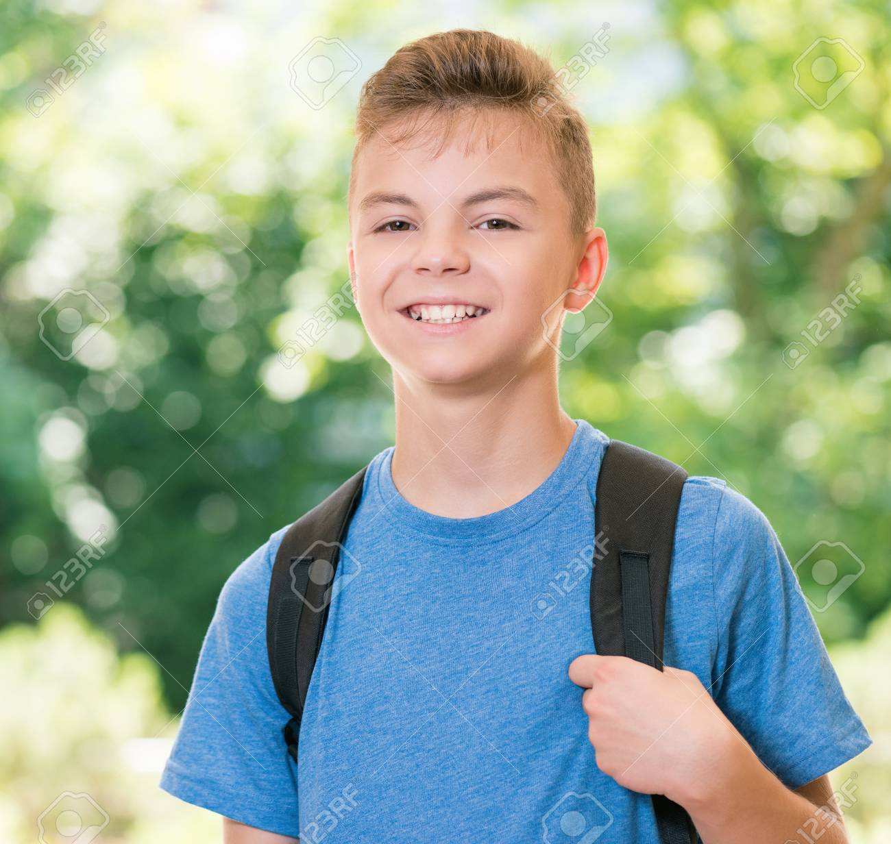 Cute Teen Boy 12 14 Year Old With Schoolbag Posing Outdoors Stock