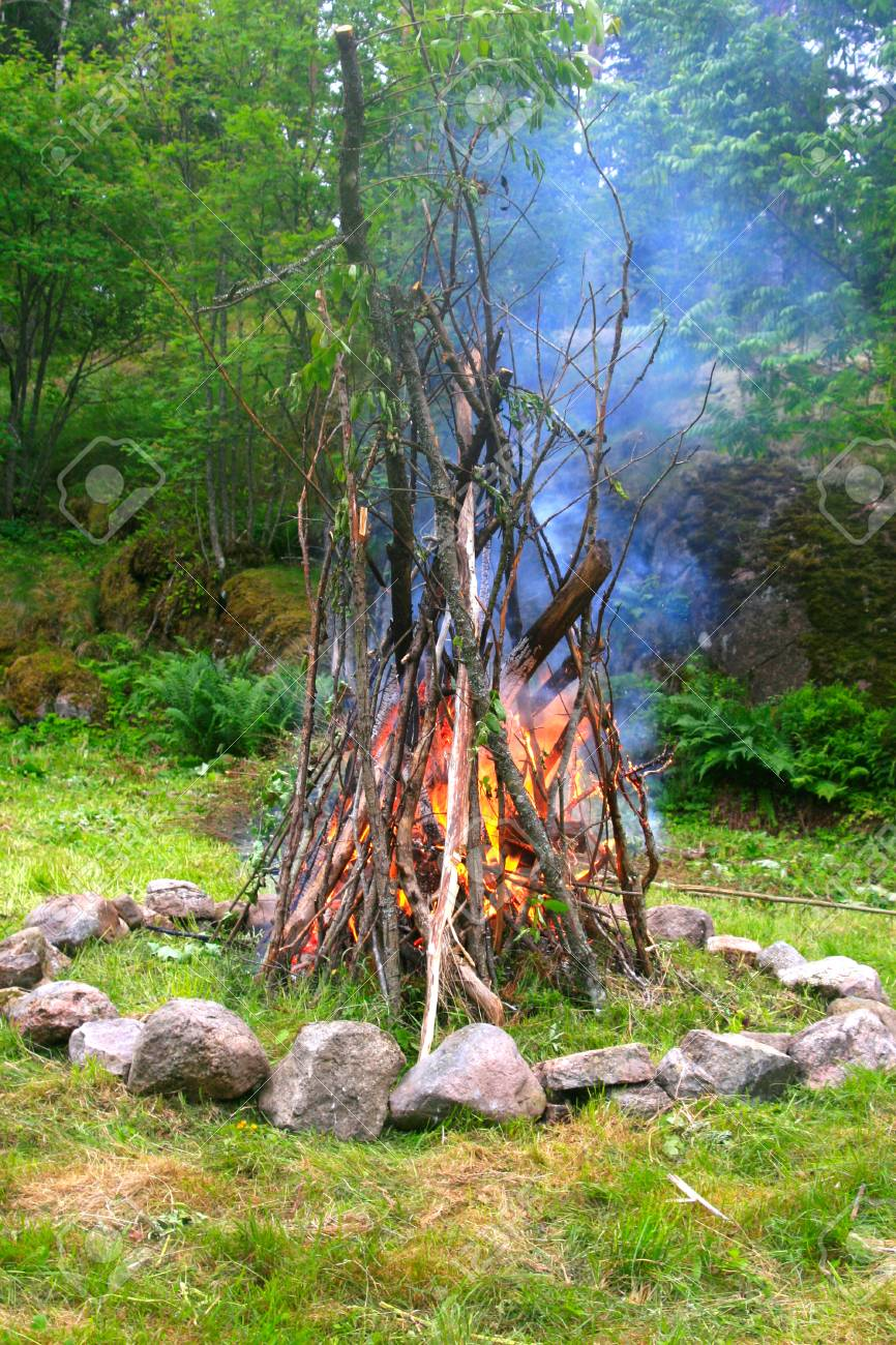 Starting A Fire At The Fireplace In Peaceful Forest Stock Photo