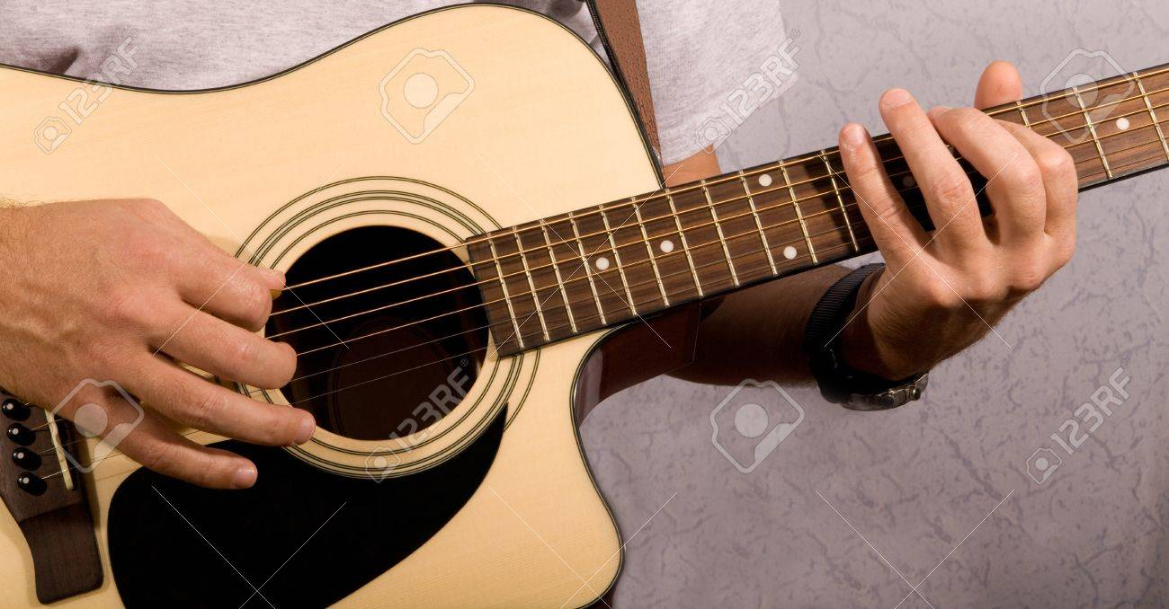 a man playing on a guitar Stock Photo - 15394089