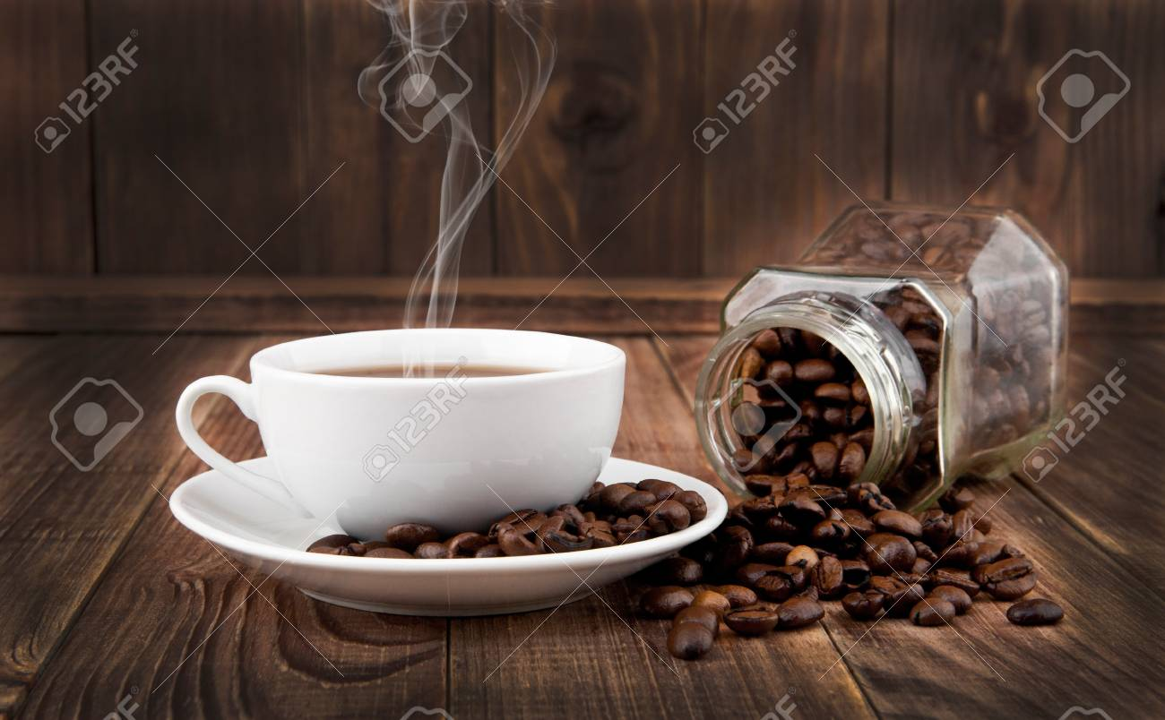 cup and grains of coffee on a wooden background Stock Photo - 16474662