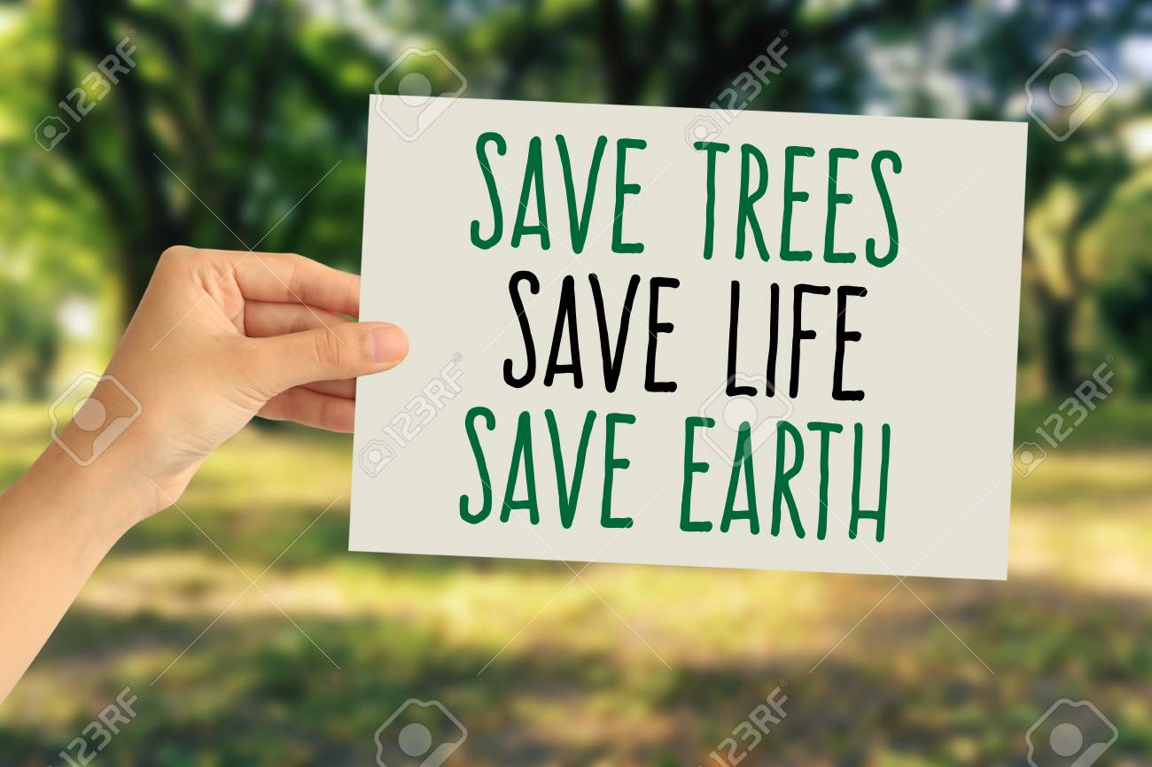 hand holding a paper card with save trees save life save earth