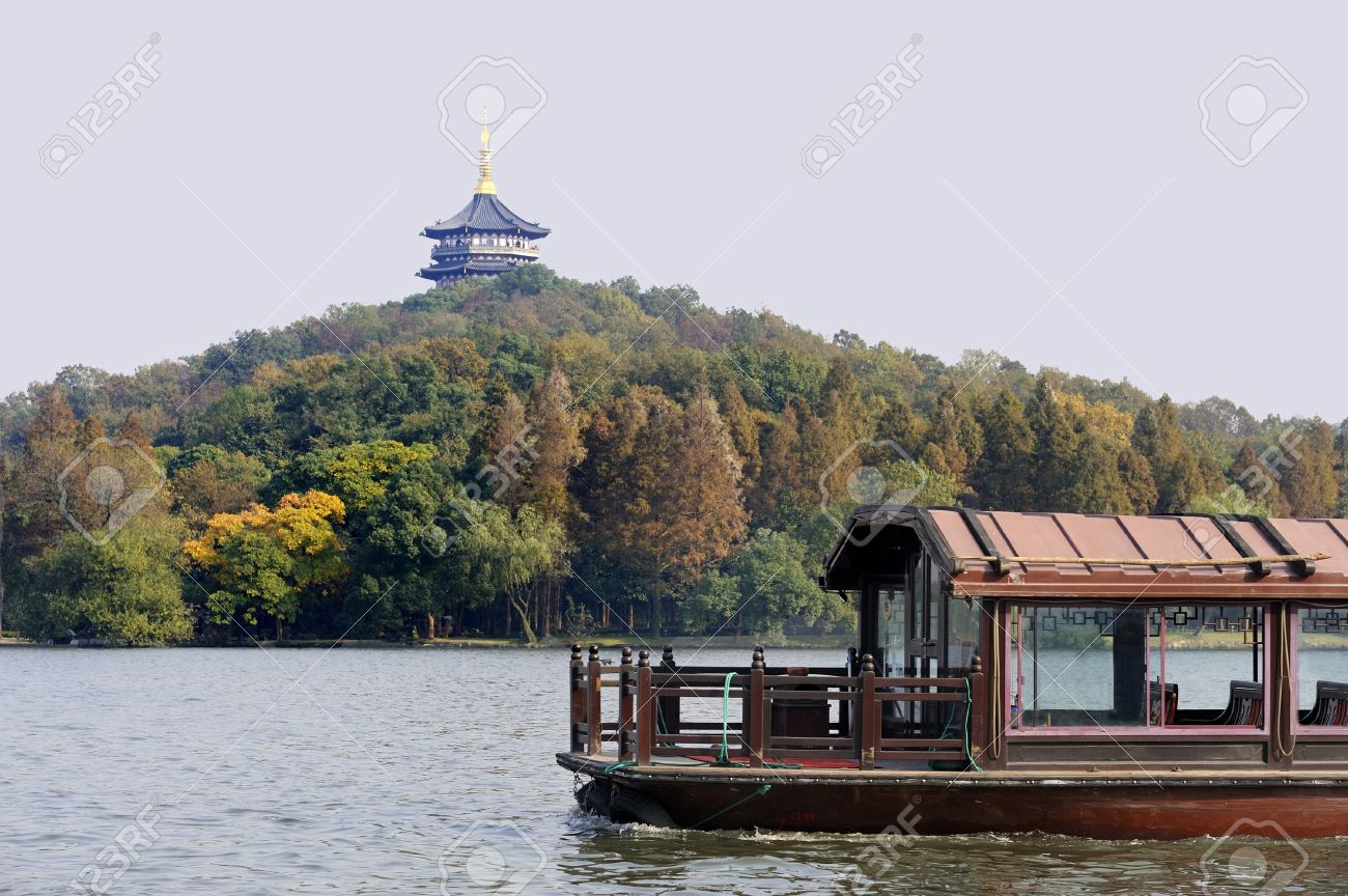 Traditional boat at the West Lake (Xihu) near Hangzhou in China. At the background a pagoda - 4263352