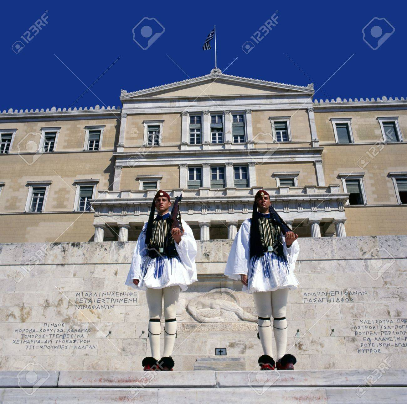 Evzones, the presidential ceremonial guards, guarding the Tomb of the Unknown Soldier at the Hellenic Parliament Building Stock Photo - 10483972
