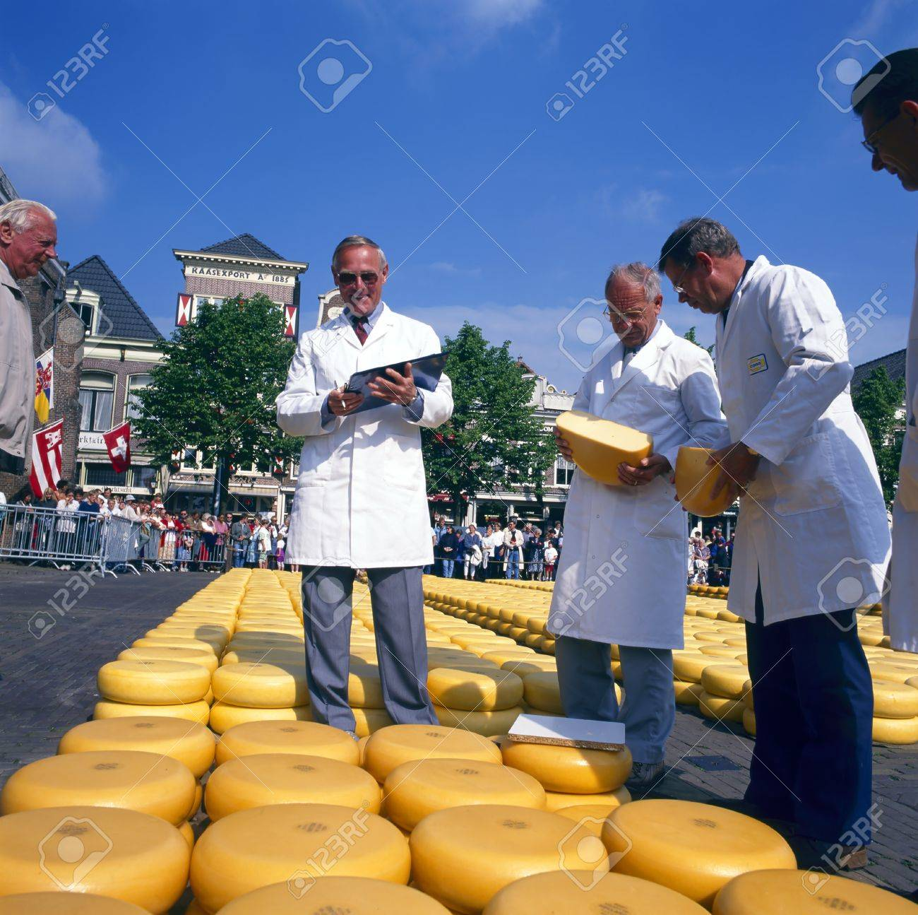 ALKMAAR, THE NETHERLANDS - AUGUST 03  Men check the cheese quality at the cheese market on August 03, 2012 in Alkmaar, Netherlands  Every Friday morning there is a typical cheese market at Alkmaar Stock Photo - 19235270
