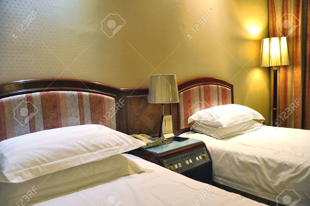 Luxurious hotel room with two separate beds Stock Photo - 32605149