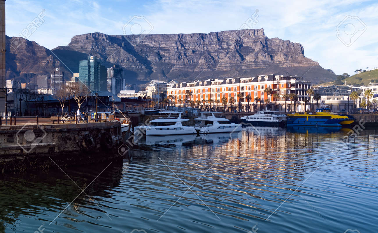 View across the water of the Cape Grace Hotel at the Victoria and Alfred Waterfront in Cape Town. Western Province, South Africa. 24 July 2021. - 173017590