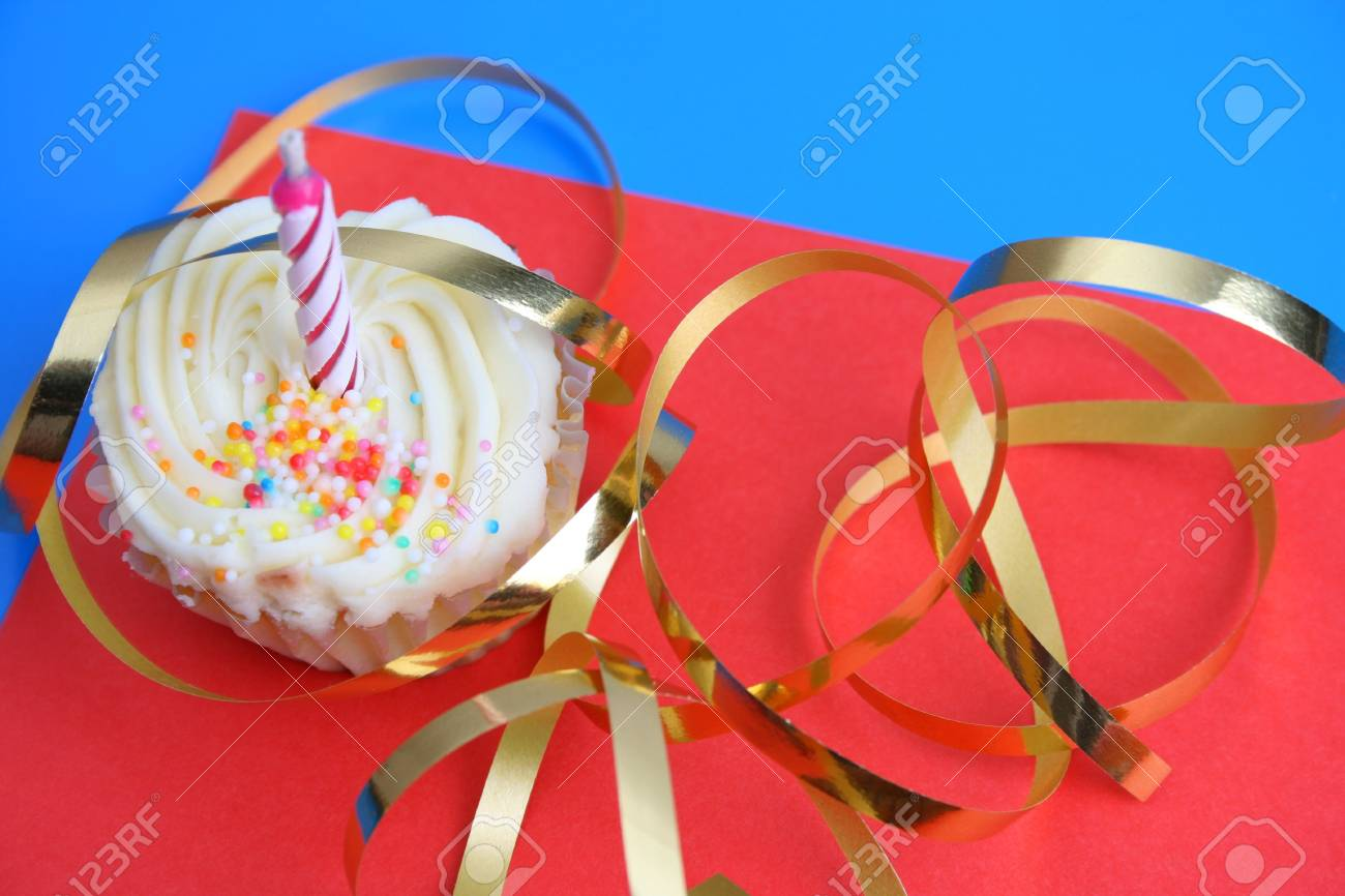 Birthday Cupcake with one candle and gold ribbon Stock Photo - 3998958