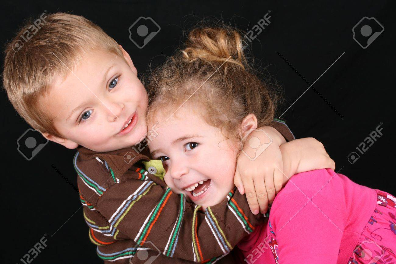 Beautiful young girl with curly hair and her cute boy friend Stock Photo - 6878610