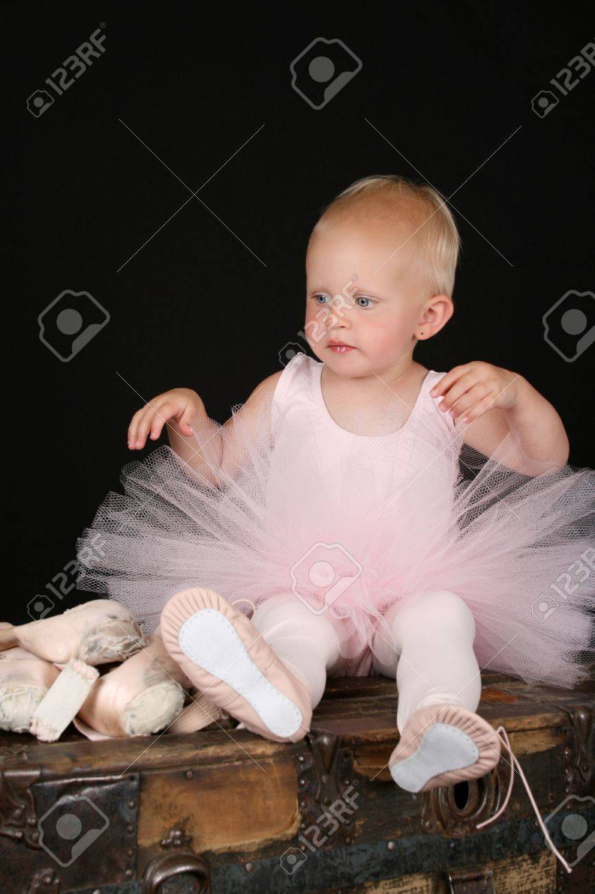 Beautiful Blond Baby Wearing A Ballet Costume Sitting Ontop Of ...