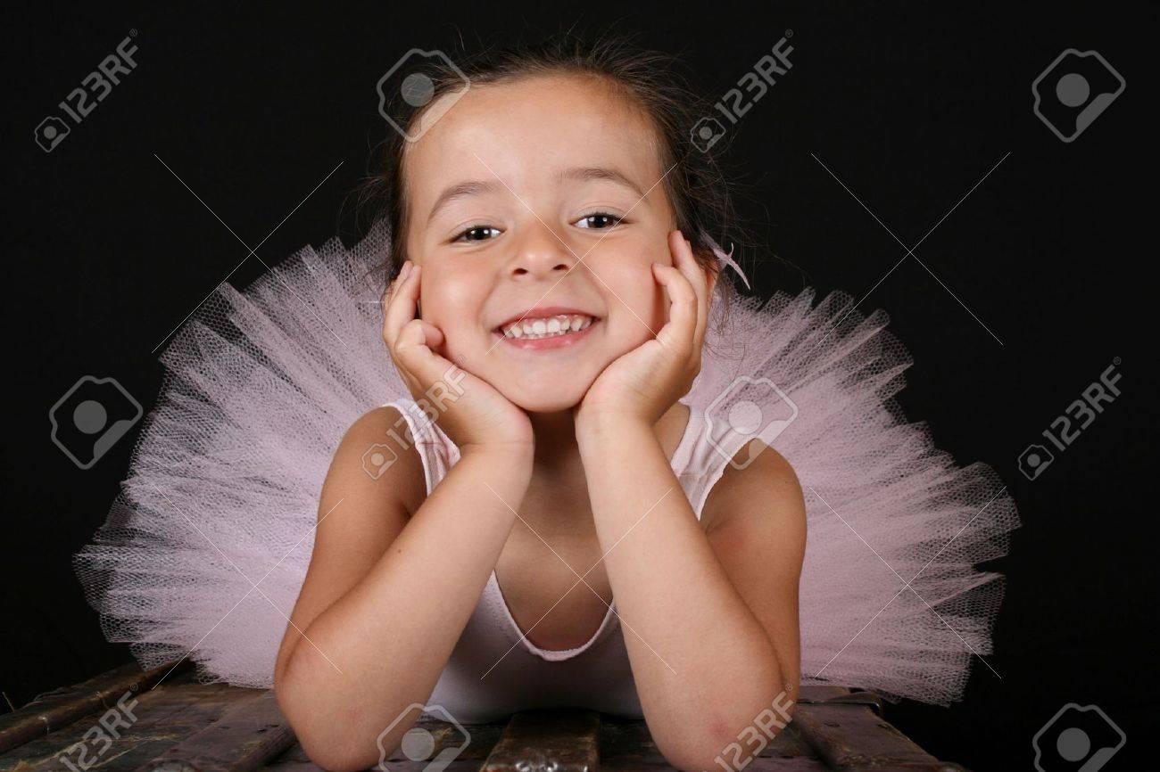 Cute brunette ballet girl wearing a pink ballet costume Stock Photo - 7516302