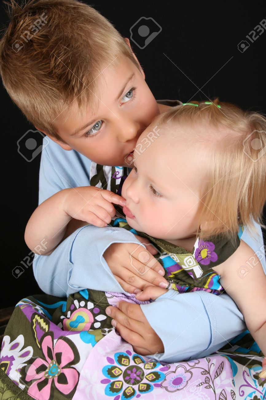 71033fec3ed5b Cute brother holding his toddler sister in his arms Stock Photo - 7941646