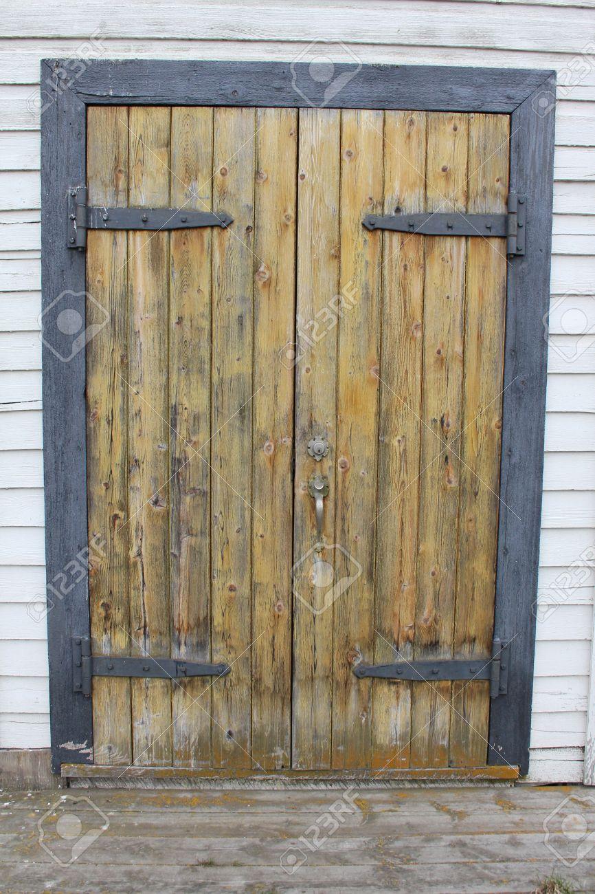 Rustic Wooden Door With Metal Hinges In Doorframe Stock Photo ...