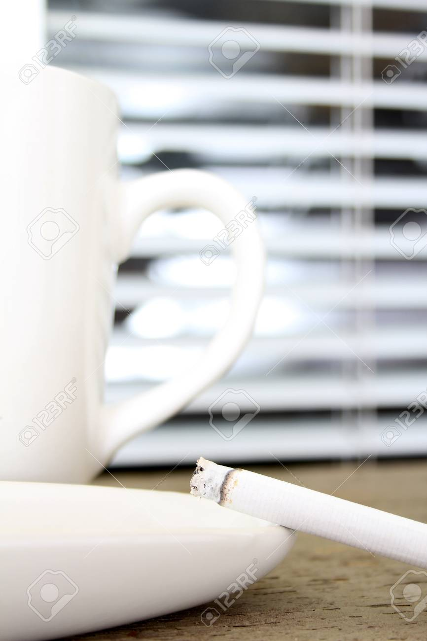 Cigarette on ashtray with cup of coffee Stock Photo - 11547827