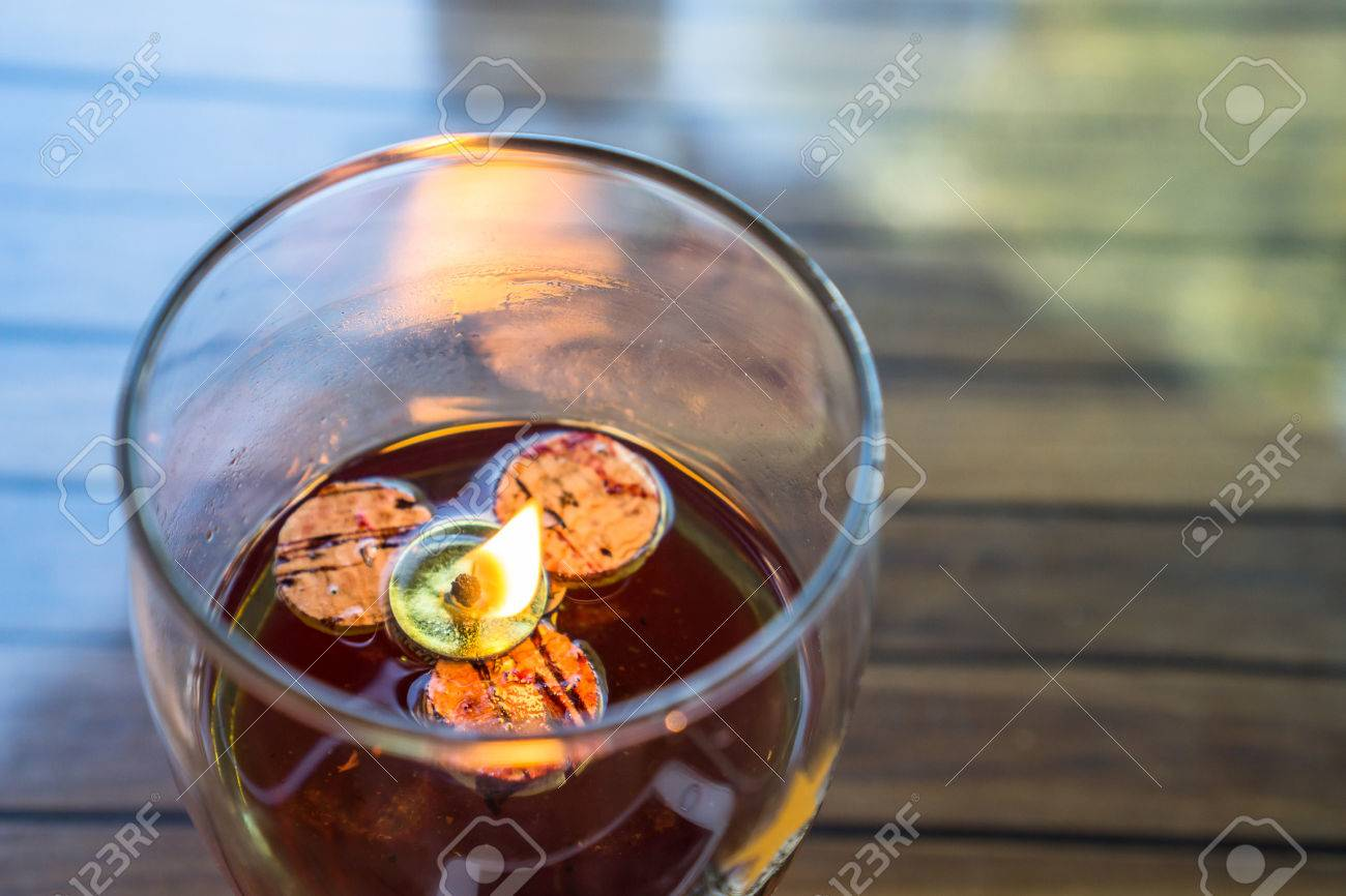 Picture of: Flame On Wick Which Is Floating In The Glass Oil Lamp Stock Photo Picture And Royalty Free Image Image 65437711