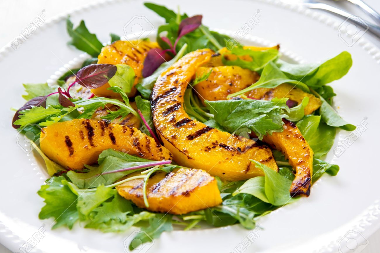 Grilled Pumpkin With Rocket And Spinach Salad Stock Photo 17332855